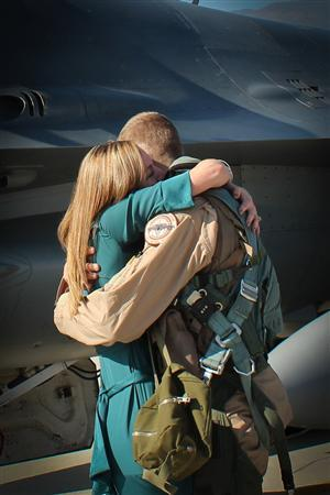 Cassy Gruenther embraces her husband, Capt. Lucas Gruenther, of the U.S. Air Force 31st Fighter Wing after returning from a deployment in 2011. Gruenther, 32, has been missing since officials at Aviano Air Base lost contact with the captain's F-16 fighter jet January 28th during a nighttime training mission over the Adriatic Sea. REUTERS/U.S. Air Force