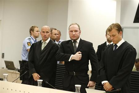 Norwegian mass killer Anders Behring Breivik gestures as he leaves the courtroom after the Oslo Court delivered the verdict of his trial in Oslo Courthouse August 24, 2012. REUTERS/Heiko Junge/NTB Scanpix/Files