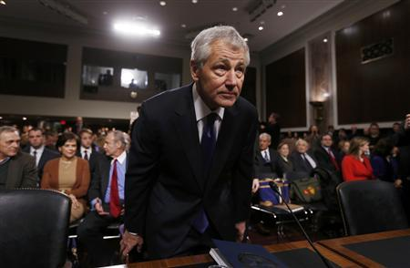 Former Sen. Chuck Hagel (R-NE) (L), sits down before giving testimony to the Senate Armed Services Committee to be Defense Secretary, on Capitol Hill in Washington, January 31, 2013. Hagel, 66, is a decorated Vietnam War veteran and a former two-term Republican senator. REUTERS/Kevin Lamarque
