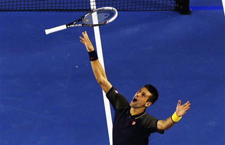 Novak Djokovic of Serbia celebrates defeating Andy Murray of Britain in their men's singles final match at the Australian Open tennis tournament in Melbourne January 27, 2013. REUTERS/David Gray