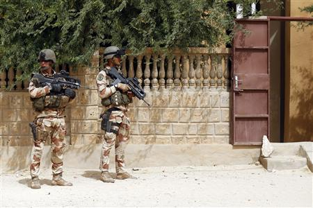 French soldiers patrol the area outside the Sankore Mosque, a world heritage site, in Timbuktu January 31, 2013. REUTERS/Benoit Tessier