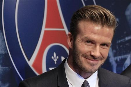 Soccer player David Beckham attends a news conference in Paris January 31, 2013. Former England captain David Beckham has joined Paris St Germain on a five-month contract, the French Ligue 1 club said on Thursday. REUTERS/Gonzalo Fuentes