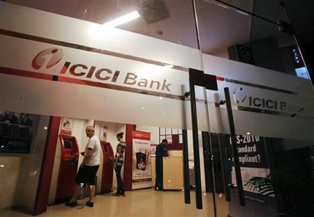 Customers use ATM machines at an ICICI Bank branch in Mumbai January 30, 2013. REUTERS/Vivek Prakash (