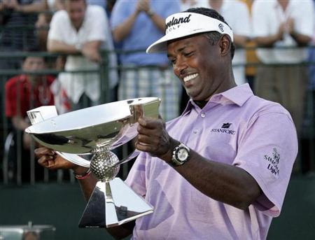 Vijay Singh of Fiji smiles as he looks at the Fedex Cup after the conclusion of the Tour Championship golf tournament at East Lake Golf Club in Atlanta, Georgia, September 28, 2008. REUTERS/Tami Chappell