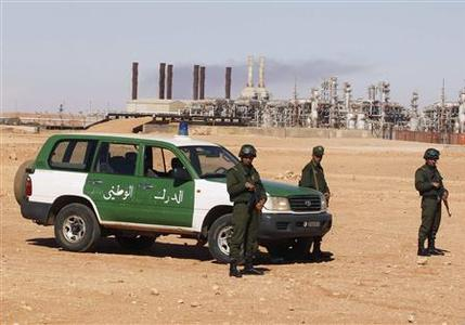 Algerian soldiers stand near the Tiguentourine Gas Plant in In Amenas, 1600 km (994 miles) southeast of Algiers, January 31, 2013. REUTERS/Louafi Larbi