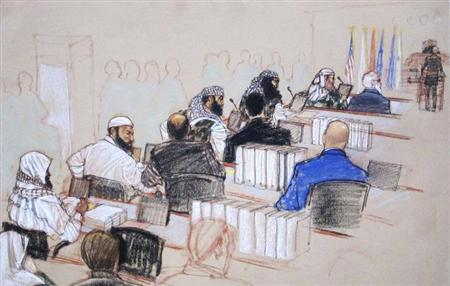 (L-R, wearing camouflage) Ramzi, Walid bin Attash and Khalid Sheikh Mohammad, three of the alleged conspirators in the 9/11 attacks, attend court dressed in camouflage during hearings in Guantanamo Bay, Cuba January 28, 2013 in this Pentagon-approved court sketch. Defense lawyer Cheryl Bormann, in hijab, stands at the podium before presiding judge Army Colonel James Pohl. REUTERS/Janet Hamlin