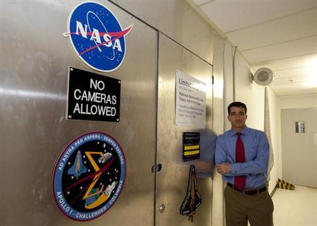 Mike Ciannilli, NASA Project Manager of the Columbia Research and Preservation Office stands near the entrance of a room, behind which houses pieces of Space Shuttle Columbia, at the Kennedy Space Center in Florida, January 30, 2013. Space Shuttle Columbia broke apart while returning to earth on February 1, 2003. REUTERS/Michael Brown