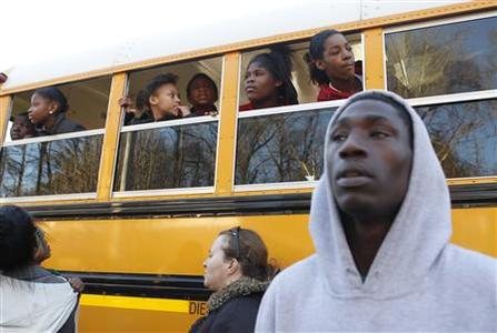 Children look for their parents from a school bus near Price Middle School following a shooting at the school in Atlanta, Georgia, January 31, 2013. One student was shot and another arrested in the latest string of school shootings. REUTERS/Tami Chappell