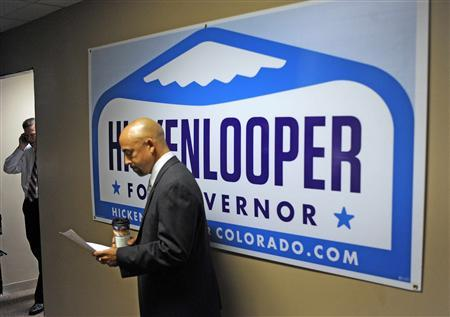 Colorado Lieutenant Governor Joe Garcia (R) looks at notes while campaigning with Colorado Governor John W. Hickenlooper in Denver, Colorado in this 2010 file photo. Garcia is a leading candidate to become secretary of labor during President Barack Obama's second term, sources familiar with the situation told Reuters on Thursday. REUTERS/Evan Semon
