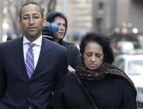 Roomy Khan, the former Intel executive exits the Manhattan Federal Courthouse with her lawyer (L) following her sentencing in New York January 31, 2013. Khan, a one-time technology company executive who became a key FBI informant in the insider-trading case against hedge-fund manager Raj Rajaratnam, was sentenced to 12 months in prison on Thursday. Defense lawyers had sought five years of probation for Khan, 58, who pleaded guilty in 2009 in U.S. District Court in Manhattan to securities fraud, obstruction of justice and conspiracy. REUTERS/Brendan McDermid