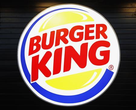 The logo of Burger King is seen on the opening day of the Burger King restaurant at the Marignane airport hall December 22, 2012. REUTERS/Jean-Paul Pelissier