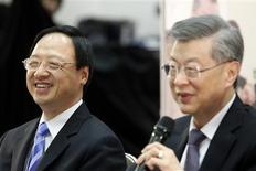 Taiwan premier Sean Chen (R) answers a question while vice premier Jiang Yih-Huah listens on during a news conference in Executive Yuan in Taipei February 1, 2013. REUTERS/Pichi Chuang