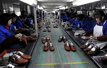 Employees work at a shoe factory in Lishui, Zhejiang province, in this January 24, 2013 file photo. REUTERS/Lang Lang/Files