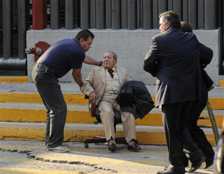 An elderly man is being helped outside the headquarters of state oil giant Pemex in Mexico City January 31, 2013. A powerful explosion rocked the Mexico City headquarters of state oil giant Pemex on Thursday, killing at least 14 people and injuring 100 others.The blast hit the lower floors of the downtown tower block, throwing debris into the streets and sending workers running outside. Interior Minister Miguel Angel Osorio Chong said the blast killed at least 14 people and injured 100. It was not yet clear what caused the explosion, and the death toll could still rise, he added. REUTERS/Alejandro Dias (MEXICO - Tags: DISASTER ENERGY POLITICS TPX IMAGES OF THE DAY)