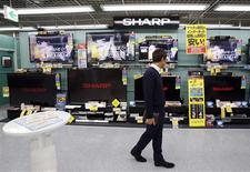 A man looks around Sharp's TV sets at an electronic shop in Tokyo February 1, 2013. REUTERS/Yuya Shino