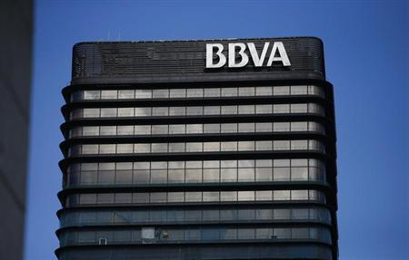 The headquarters of Spanish bank BBVA are seen in Madrid October 31, 2012. BBVA, Spain's second-biggest bank, reported a 47 percent drop in nine-month net profit on Wednesday, after it wrote off billions of euros of losses on bad real estate investments. Profit margins at Spanish banks are waning as they belatedly recognise the effects of a decade-long housing boom that crashed in 2008, leading the government to ask for a 100 billion euro ($129 billion) credit line from Europe to bail out the weakest. REUTERS/Juan Medina (SPAIN - Tags: BUSINESS)
