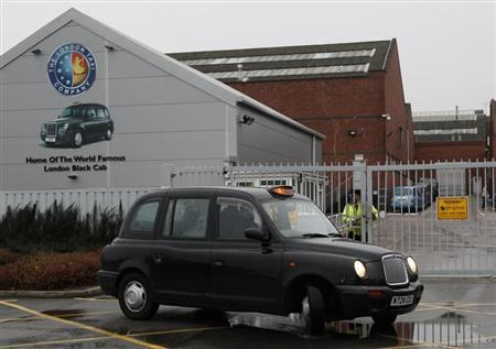 A taxi is driven away from the London Taxi Company in Coventry, central England, October 22, 2012. REUTERS/Darren Staples