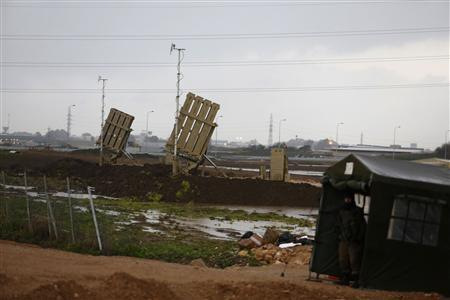 An Israeli soldier stands guard next to Iron Dome rocket interceptor batteries deployed near the northern Israeli city of Haifa January 31, 2013. REUTERS/Baz Ratner