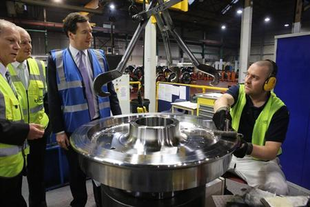 Chancellor of the Exchequer George Osborne tours a factory of train wheel manufacturers Lucchini UK, at Trafford Park in Manchester, January 28, 2013. REUTERS/Christopher Furlong/POOL