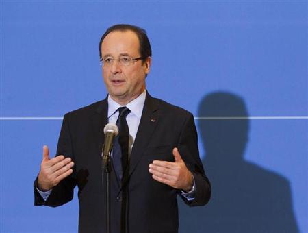 French President Francois Hollande speaks to journalists in Grenoble about the liberation of Florence Cassez January 23, 2013. REUTERS/Robert Pratta