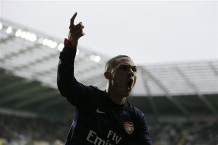 Arsenal's Kieran Gibbs celebrates after scoring against Swansea City during their FA Cup third round soccer match at the Liberty Stadium in Swansea, South Wales, January 6, 2013. REUTERS/Stefan Wermuth