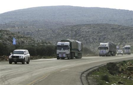A convoy formed by a delegation of United Nations High Commissioner for Refugees and Syrian Arab Red Crescent carry humanitarian aid as they drive in Aleppo's countryside January 30, 2013.