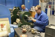 Employees of JJ Churchill precision engineering polish turbine blades in the company's factory in Market Bosworth, central England, October 10, 2012. REUTERS/Tom Bergin