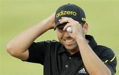Spain's Sergio Garcia reacts during the final round of the Commercial Bank Qatar Masters at the Doha Golf Club January 26, 2013. REUTERS/Mohammed Dabbous