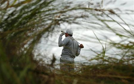 Sergio Garcia of Spain watches his tee shot on the fifth hole during the second round of the British Open golf championship at Royal Lytham & St Annes, northern England July 20, 2012. REUTERS/Brian Snyder