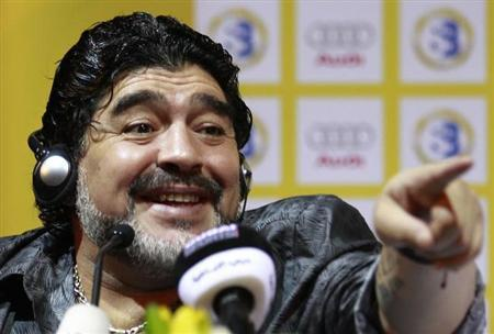 Diego Maradona of Argentina gestures during a news conference in Dubai, September 11, 2011. REUTERS/Jumana El Heloueh/Files