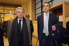 Gli avvocati dell'ex premier Silvio Berlusconi Pietro Longo, a sinistra, e Nicolò Ghedini in una foto dell'11 marzo 2011. REUTERS/Alessandro Garofalo
