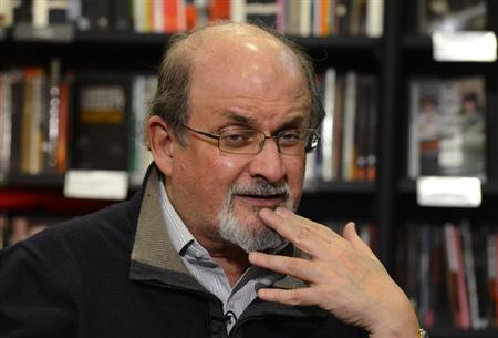 Author Salman Rushdie gestures during an interview with Reuters in central London, September 28, 2012. REUTERS/Paul Hackett/Files