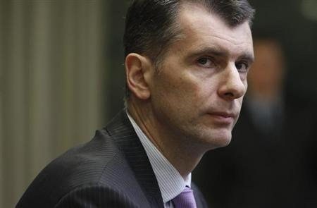 Russian businessman Mikhail Prokhorov looks on during a news conference in Moscow January 23, 2012. REUTERS/Denis Sinyakov