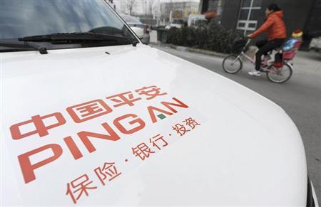 A woman rides a bicycle carrying her child past a car bearing the company logo of Ping An Insurance, in Hefei, Anhui province January 11, 2013. REUTERS/Stringer