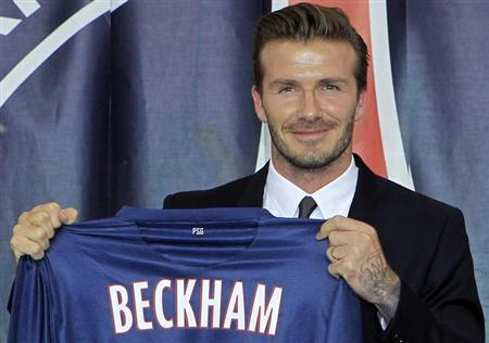 Soccer player David Beckham presents his new jersey after a news conference in Paris January 31, 2013. REUTERS/Gonzalo Fuentes