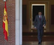 Spain's Prime Minister Mariano Rajoy walks out a door at the Moncloa Palace in Madrid in this January 30, 2013 file photo. REUTERS/Paul Hanna/Files