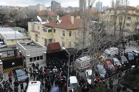 Riot police block a street after an explosion at the entrance (far right) of the U.S. embassy in Ankara February 1, 2013