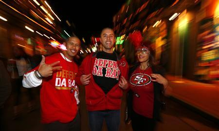 San Francisco 49ers fans celebrate on Bourbon Street in the French Quarter during Super Bowl week in New Orleans, January 31, 2013. Super Bowl XLVII will be played between the San Francisco 49er and the Baltimore Ravens on February 3. REUTERS/Jeff Haynes