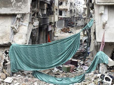 Curtains erected as protection from snipers loyal to Syria's President Bashar al-Assad are seen in a neighbourhood of Homs January 30, 2013. REUTERS/Yazan Homsy