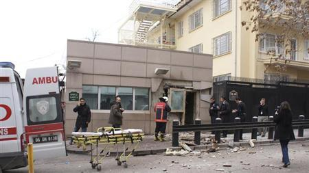 Security officers inspect the site after an explosion at the entrance of the U.S. embassy in Ankara February 1, 2013. REUTERS/Ihlas News Agency/IHA
