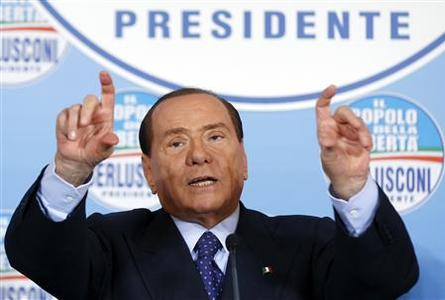 Former Italian Prime Minister Silvio Berlusconi gestures during a news conference at the headquarter of People of Freedom Party (PDL) in Rome February 1, 2013. REUTERS/Alessandro Bianchi