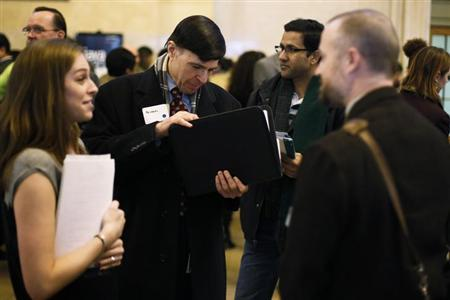 A man looks for a copy of his resume to give to a recruiter at a job fair put on by online recruiting company TheLadders at Grand Central Station in New York, January 10, 2013. REUTERS/Lucas Jackson