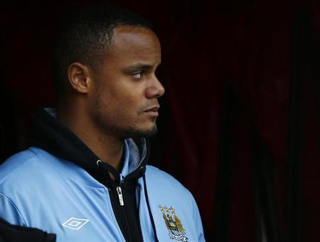 Manchester City's Vincent Kompany stands in the tunnel after receiving an injury during their FA Cup fourth round match against Stoke City at the Britannia Stadium in Stoke-on-Trent, northern England, January 26, 2013. REUTERS/Darren Staples