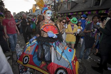A reveler wearing tents as costume dances during Mardi Gras festivities in New Orleans, Louisiana February 21, 2012. REUTERS/Lee Celano/Files