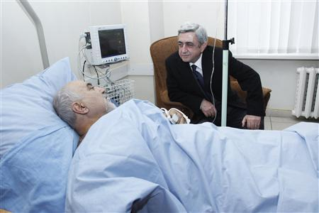 Armenia's President Serzh Sarksyan (R) visits injured presidential candidate Paruyr Hayrikyan at the hospital in Yerevan, February 1, 2013. An assassination attempt on a presidential candidate in Armenia has thrown this month's election into doubt and could threaten stability in the volatile Caucasus region that carries oil and natural gas to Europe. REUTERS/PanArmenianPhoto/Tigran Mehrabyan/Handout