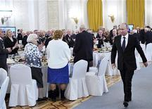 Russia's President Vladimir Putin (R) arrives at the reception in honour of the Battle of Stalingrad in Moscow in this picture provided by Ria Novosti February 1, 2013. Stalingrad will be back on the map for a few hours on Saturday, and Josef Stalin's face will be splashed on buses, as Russia remembers the battle that turned the tide of World War Two. REUTERS/Alexei Nikolsky/Ria Novosti/Pool