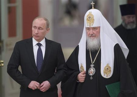 Russia's President Vladimir Putin (L) and Patriarch of Moscow and All Russia Kirill arrive for the meeting with Russian Orthodox church bishops in Moscow February 1, 2013, in this picture provided by Ria Novosti. REUTERS/Sergei Gunyeev/Ria Novosti/Pool