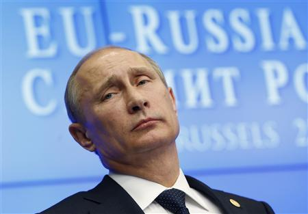 Russian President Vladimir Putin looks on during a joint news conference with European Council President Herman Van Rompuy and European Commission President Jose Manuel Barroso (unseen) following a European Union-Russia summit in Brussels December 21, 2012. REUTERS/Francois Lenoir