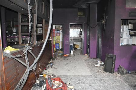 A view of the Boate Kiss nightclub is seen in the southern city of Santa Maria, 187 miles (301 km) west of the state capital Porto Alegre in this handout photo released by the Policia Civil (Civil Police) January 29, 2013. A fire at the nightclub killed at least 231 people in Santa Maria early on Sunday when a band's pyrotechnics show set the building ablaze and fleeing partygoers stampeded toward blocked and overcrowded exits in the ensuing panic, officials said. REUTERS/Policia Civil/Handout