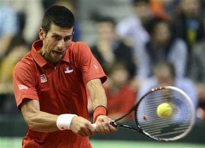 Novak Djokovic of Serbia returns the ball to Olivier Rochus of Belgium during their world group first round match in the Davis Cup tennis tournament in Charleroi February 1, 2013. REUTERS/Laurent Dubrule